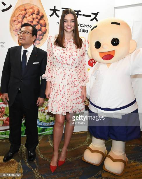 Miranda Kerr and Tokio Aoki President of Marukome Co Ltd attend the promotional event for Marukome Kojiamazake sweet rice sake at Shinagawa Goos on...