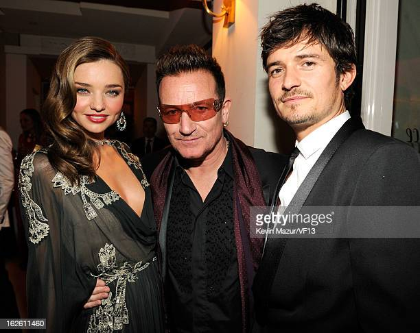 Miranda Kerr Bono and Orlando Bloom attend the 2013 Vanity Fair Oscar Party hosted by Graydon Carter at Sunset Tower on February 24 2013 in West...