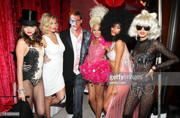 Miranda Kerr Kate Upton Mark Birnbaum Christine Teigen Nicole Trunfio and Jaslene Gonzalez attends Miranda Kerr's Sexy Circus Halloween Party at...