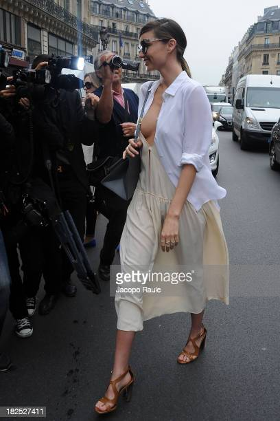 Miranda Kerr leaves Stella McCartney Fashion Show during Paris Fashion Week Womenswear SS14 Day 7 on September 30 2013 in Paris France
