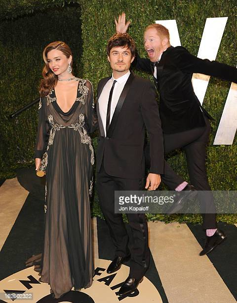 Miranda Kerr, Orlando Bloom and Jesse Tyler Ferguson attend the 2013 Vanity Fair Oscar party at Sunset Tower on February 24, 2013 in West Hollywood,...