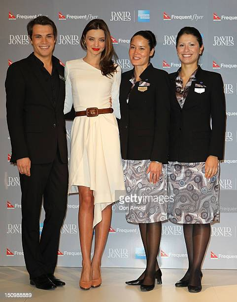 Miranda Kerr poses alongside Qantas models during the David Jones AMEX Press Conference at David Jones Castlereagh St store on August 30 2012 in...