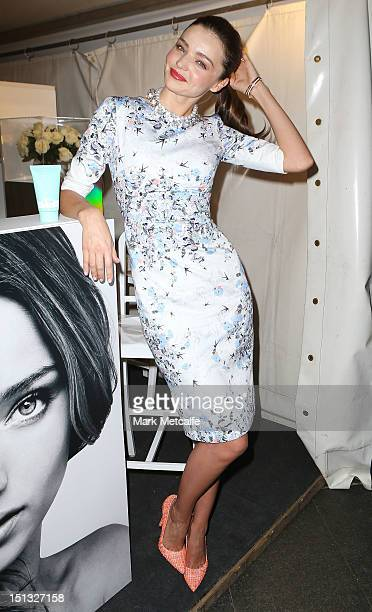 Miranda Kerr poses at a Kora Organics pop up store in Martin Place as part of Fashion's Night Out on September 6 2012 in Sydney Australia