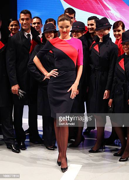 Miranda Kerr showcases the Qantas uniform alongside Qantas staff during the Qantas uniform unveiling at Hordern Pavilion on April 16 2013 in Sydney...