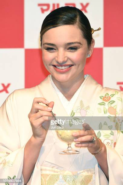Miranda Kerr tries 'kiwi banana gelato' during the promotional event for Marukome Kojiamazake sweet rice sake at Shinagawa Goos on January 10 2019 in...
