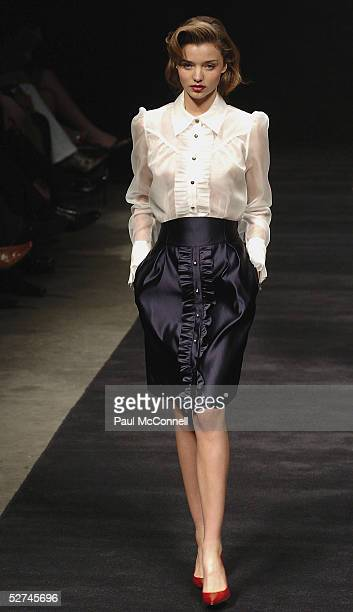 Miranda Kerr walks down the runway during the Jayson Brunsdon Collection show at the Cargo Hall in the Overseas Passenger Terminal during the...