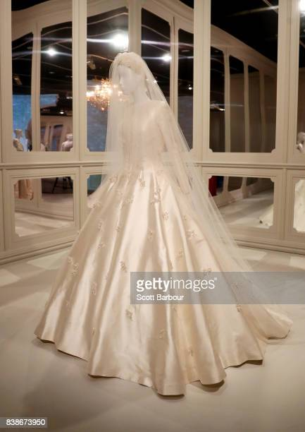 Miranda Kerr's custommade Christian Dior Couture wedding dress after she married Evan Spiegel is seen on display during a media preview of The House...
