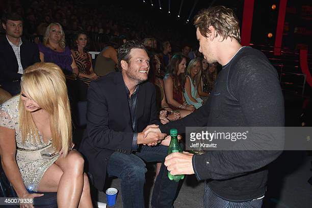 Miranda Lambert and Blake Shelton greet guests at the 2014 CMT Music awards at the Bridgestone Arena on June 4 2014 in Nashville Tennessee