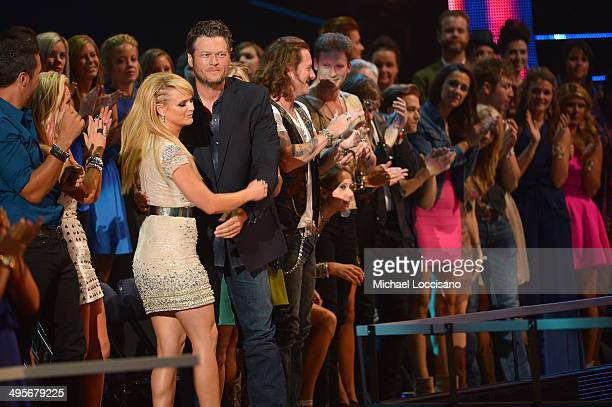 Miranda Lambert and Blake Shelton onstage at the 2014 CMT Music Awards at Bridgestone Arena on June 4 2014 in Nashville Tennessee