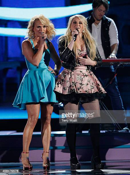 Miranda Lambert and Meghan Trainor perform during the 48th annual CMA awards at the Bridgestone Arena on November 5 2014 in Nashville Tennessee