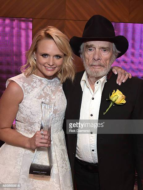 Miranda Lambert and Merle Haggard attend the 2014 CMT Artists Of The Year at the Schermerhorn Symphony Center on December 2 2014 in Nashville...