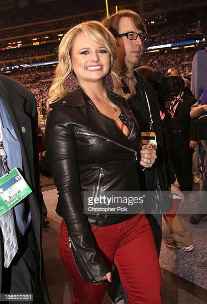 "Miranda Lambert exits after performing ""America the Beautiful"" during the Bridgestone Super Bowl XLVI Pregame Show at Lucas Oil Stadium on February 5..."