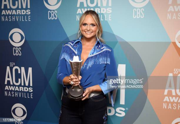 """Miranda Lambert poses with the Musical Event of the Year award for """"Fooled Around And Fell In Love"""" at the 55th Academy of Country Music Awards at..."""