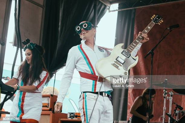Miranda Markley aka Miranda Plastic and Tyson Markley aka Tyson Plastic of The Fantastic Plastics perform during the 2017 Vans Warped Tour at...