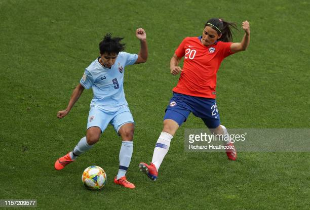 Miranda Nild of Thailand is challenged by Daniela Zamora of Chile during the 2019 FIFA Women's World Cup France group F match between Thailand and...