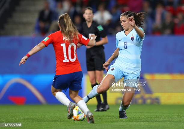 Miranda Nild of Thailand is challenged by Yanara Aedo of Chile during the 2019 FIFA Women's World Cup France group F match between Thailand and Chile...