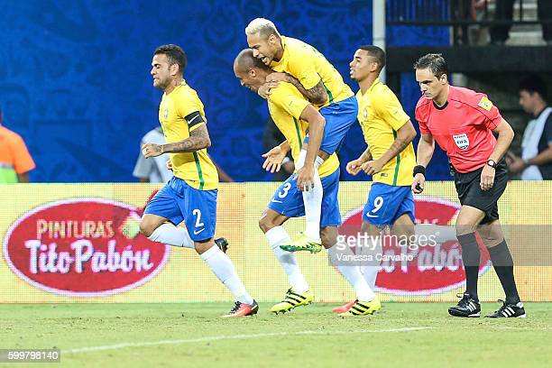 Miranda of Brazil celebrates with teammates after scoring during a match between Brazil and Colombia as part of FIFA 2018 World Cup Qualifiers at...