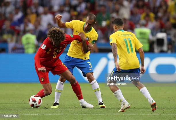 Miranda of Brazil challenges Marouane Fellaini of Belgium during the 2018 FIFA World Cup Russia Quarter Final match between Brazil and Belgium at...