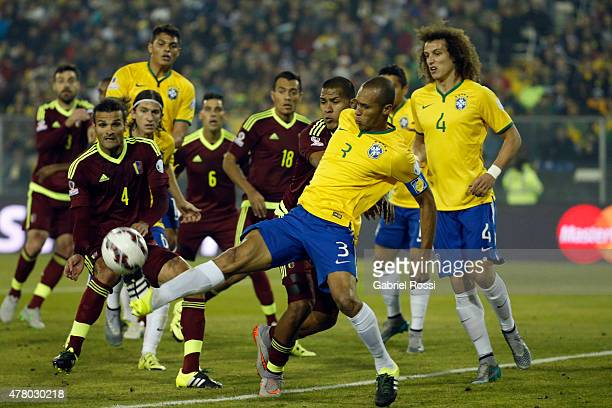 Miranda of Brazil kicks the ball during the 2015 Copa America Chile Group C match between Brazil and Venezuela at Monumental David Arellano Stadium...