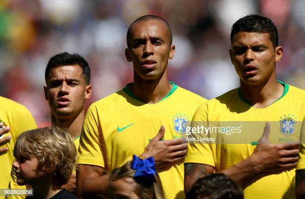 Miranda of Brazil sings the national anthem prior to the International Friendly match between Croatia and Brazil at Anfield on June 3 2018 in...