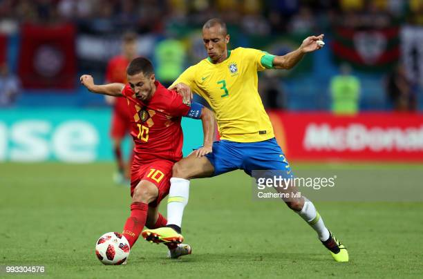 Miranda of Brazil tackles Eden Hazard of Belgium during the 2018 FIFA World Cup Russia Quarter Final match between Brazil and Belgium at Kazan Arena...