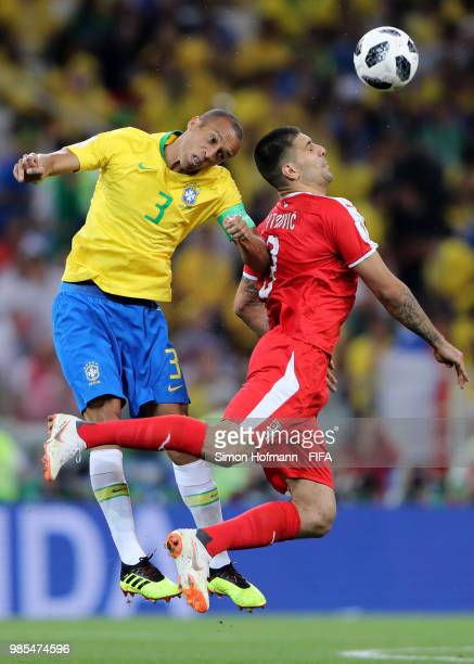 Miranda of Brazil wins a header over Aleksandar Mitrovic of Serbia during the 2018 FIFA World Cup Russia group E match between Serbia and Brazil at...