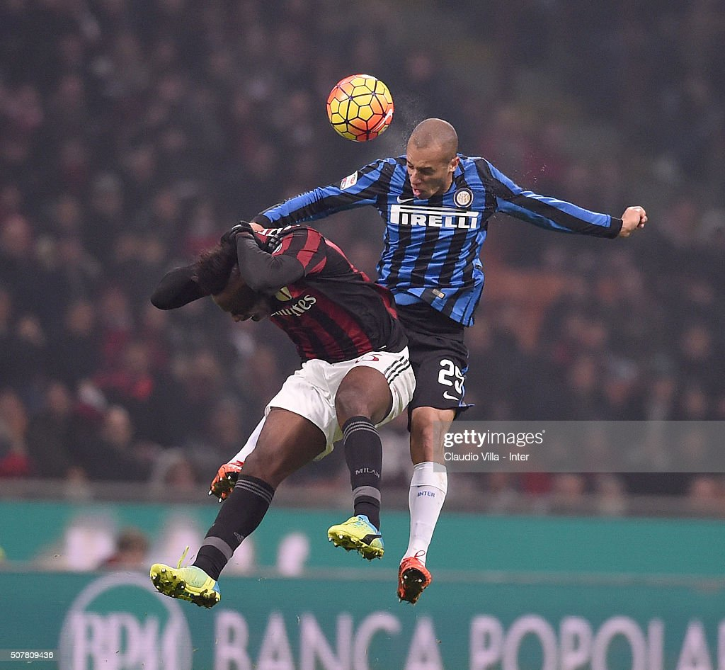 Miranda of FC Internazionale (R) and Mario Balotelli of AC Milan during the Serie A match between AC Milan and FC Internazionale Milano at Stadio Giuseppe Meazza on January 31, 2016 in Milan, Italy.