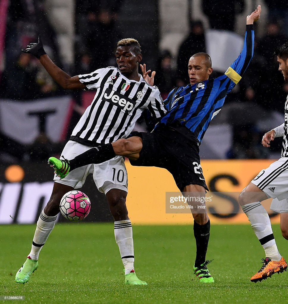 Miranda of FC Internazionale and Paul Pogba of Juventus (L) compete for the ball during the Serie A match between Juventus FC and FC Internazionale Milano at Juventus Arena on February 28, 2016 in Turin, Italy.