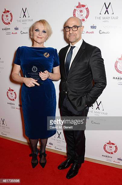 Miranda Richardson, winner of the Dilys Powell Award for Excellence In Film, and presenter Stanley Tucci pose in the Winners Room at The London...