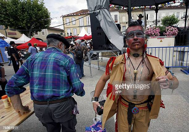 An Indian dressed person pass in the French southwestern village of Mirande on the opening day of France's biggest country music festival headed this...
