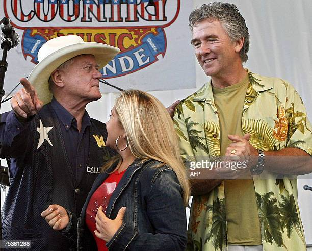 Famous US soap opera Dallas's heroes Larry Hagman Charlene Tilton and Patrick Duffy pose on stage upon their arrival at France's biggest country...