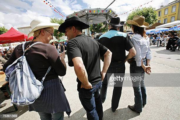 People attend the opening of France's biggest country music festival headed this year by the Dallas cast 11 July 2007 in Mirande southwest of France...