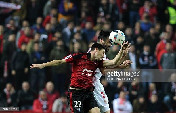 Mirandes' forward Alex Garcia vies with Sevilla's midfielder Iborra during the Spanish Copa del Rey football match Sevilla FC vs CD Mirandes at the...