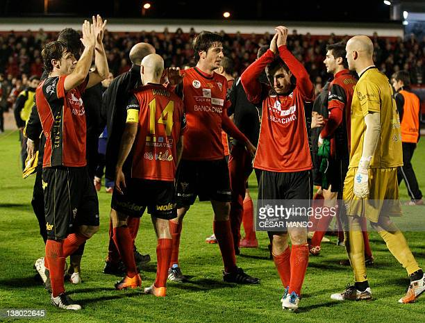 Mirandes players applaud after the Spanish cup semi-final match Mirandes vs Athletic de Bilbao on January 31, 2012 at the Anduva stadium in Miranda...