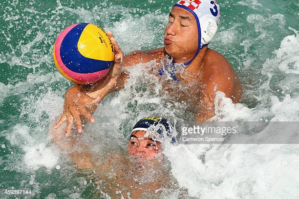 Miras Aubakirov of Kazakhstan is blocked by Brandley Ignatius Legawa of Indonesia during the Beach Water Polo match between Indonesia and Kazakhstan...