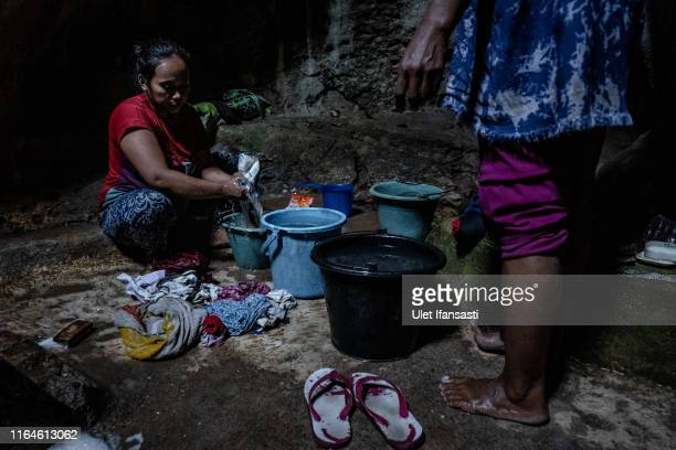 Miratin washes clothes inside a cave at Klepu village Sawahan Kulon on August 28 2019 in Pacitan East Java province Indonesia During the height of...