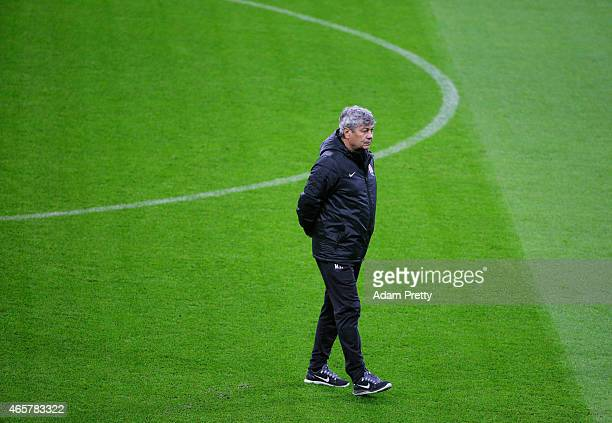 Mircea Lucescu Head Coach of Shakhtar Donetsk walks on the pitch during the Shakhtar Donetsk training session and press conference at Allianz Arena...