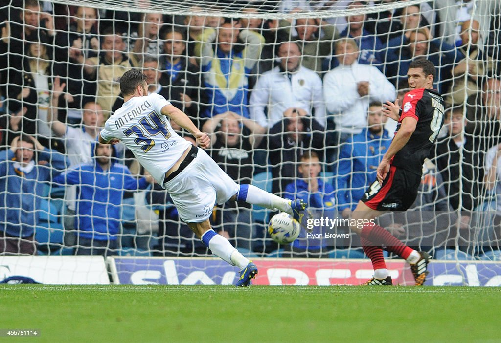 Mirco Antenucci (L) of Leeds in action during Sky Bet Championship match between Leeds United and Huddersfield Town at Elland Road Stadium on September 20, 2014 in Leeds, United Kingdom.