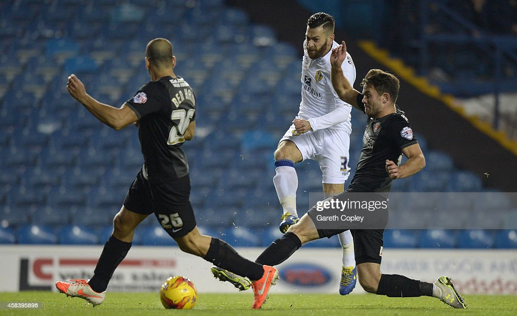 Mirco Antenucci of Leeds United gets past Tal Ben Haim and Rhoys Wiggins of Charlton Athletic during the Sky Bet Championship match between Leeds United and Charlton Athletic at Elland Road on November 4, 2014 in Leeds, England.