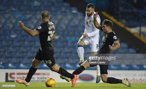 Mirco Antenucci of Leeds United gets past Tal Ben Haim and Rhoys Wiggins of Charlton Athletic during the Sky Bet Championship match between Leeds...