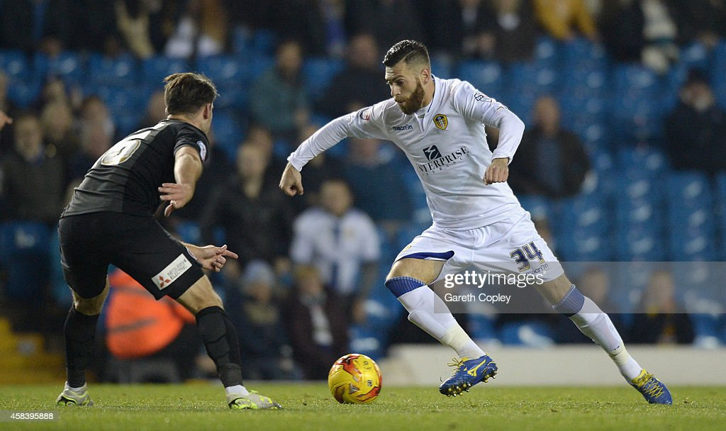 Mirco Antenucci of Leeds United gets past Tal Ben Haim of Charlton Athletic during the Sky Bet Championship match between Leeds United and Charlton Athletic at Elland Road on November 4, 2014 in Leeds, England.