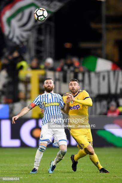 Mirco Antenucci of Spal and Andrea Barzagli of Juventus during the serie A match between Spal and Juventus at Stadio Paolo Mazza on March 17 2018 in...