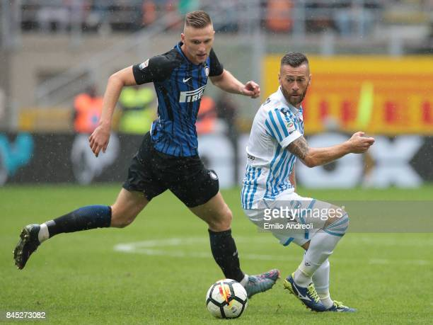 Mirco Antenucci of Spal is challenged by Milan Skriniar of FC Internazionale Milano during the Serie A match between FC Internazionale and Spal at...