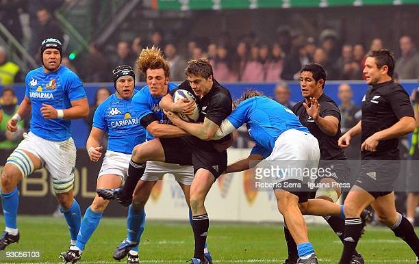 Mirco Bergamasco and Martin Castrogiovanni tackle Mike Delany during the international match between Italy and New Zealand at the San Siro Stadium on...