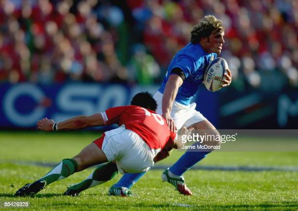 Mirco Bergamasco of Italy is tackled by Bradley Davies of Wales during the RBS 6 Nations Championship match between Italy and Wales at the Stadio...
