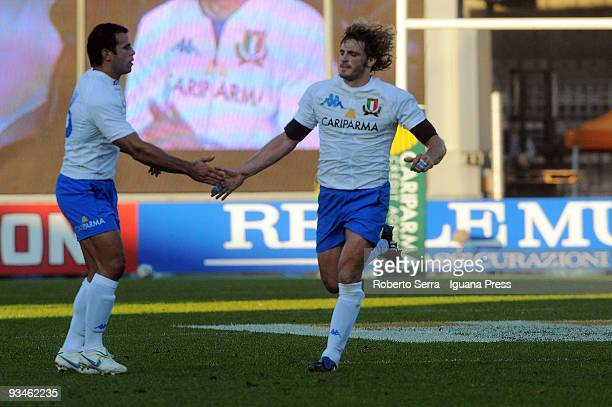 Mirco Bergamasco of Italy shakes hands with his teammate Gonzalo Canale after scoring a penalty during the friendly match between Italy and Samoa at...