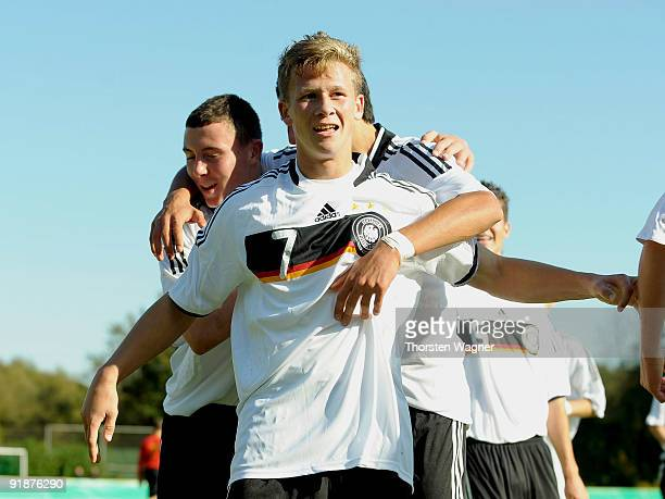 Mirco Born of Germany celebrates after scoring the first goal with his team mates during the U16 international friendly match between Germany and...