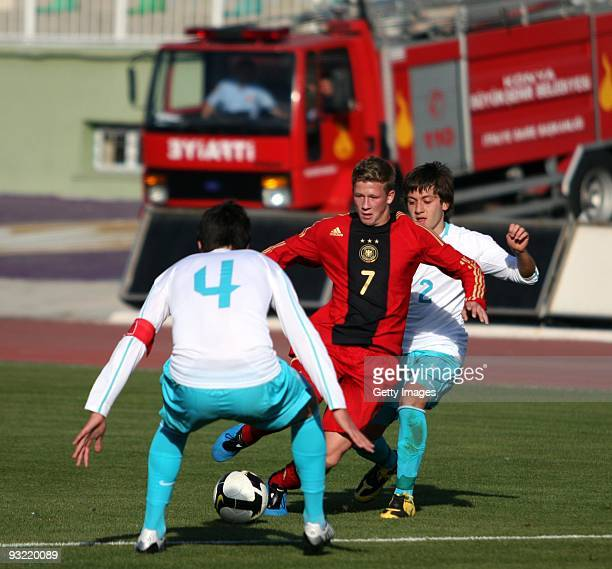 Mirco Born of Germany tries to save the ball from Cankurt and Fatih Eser of Turkey during the U16 International Friendly Match between Turkey and...