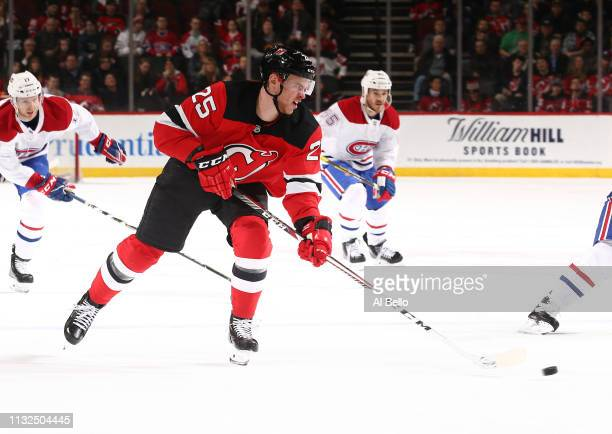 Mirco Mueller of the New Jersey Devils in action against the Montreal Canadiens during their game at Prudential Center on February 25, 2019 in...