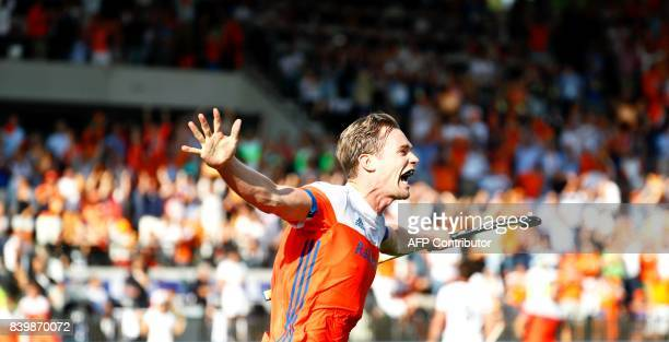 Mirco Pruyser of The Netherlands celebrates after scoring a goal during the men's final match between The Netherlands and Belgium at The European...